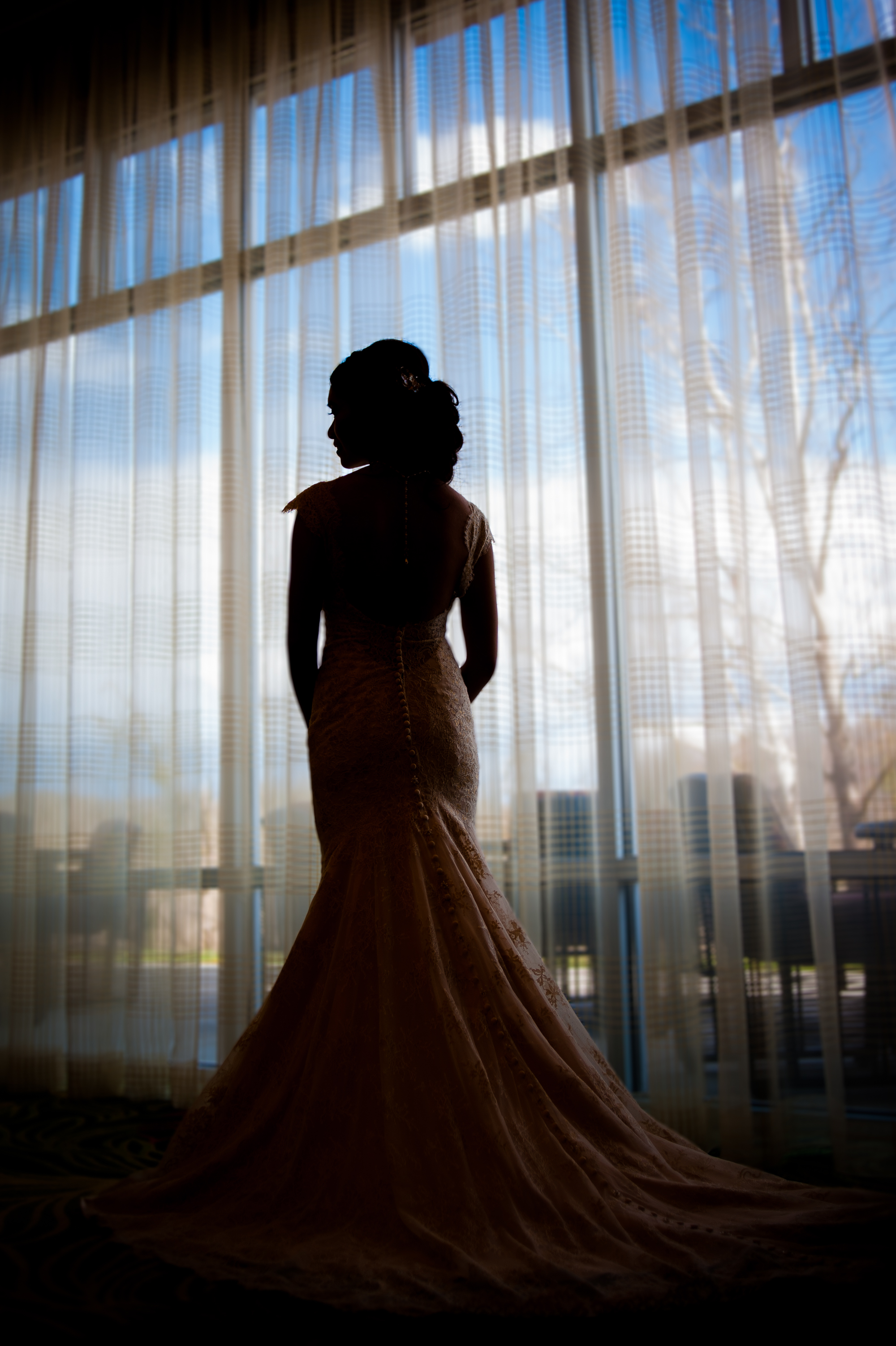 bride silhouet in asheville hotel window