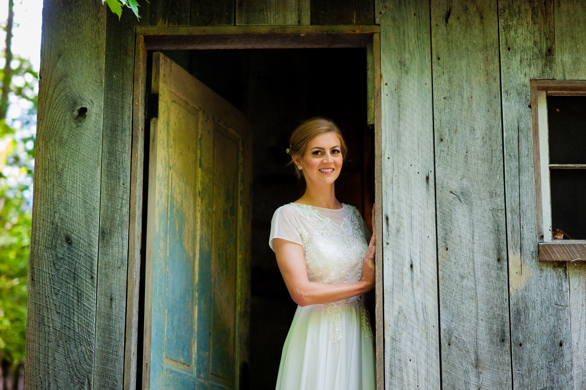 bride in bettys cottage on her wedding day