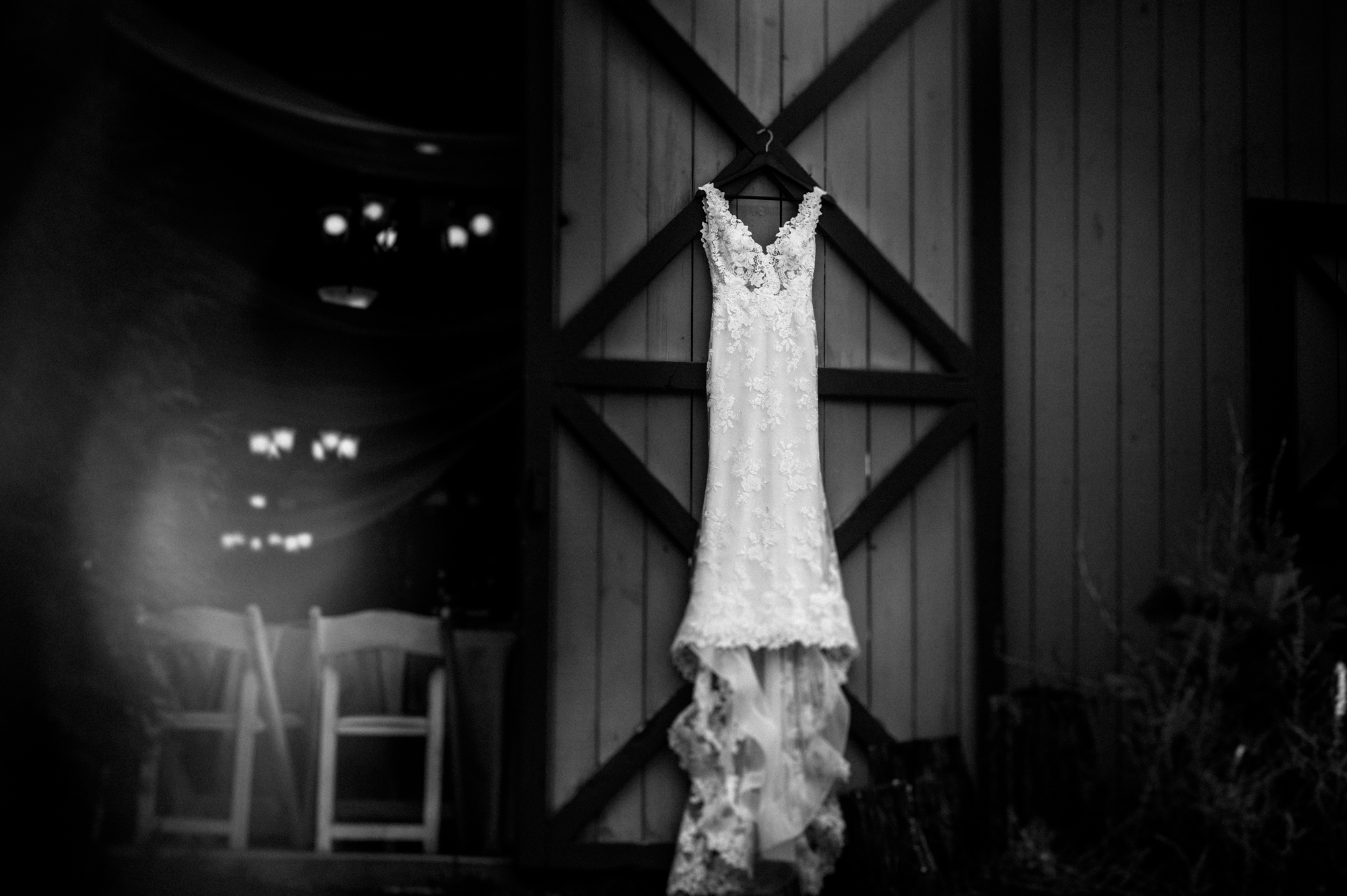 wedding dress hanging from a barn in asheville