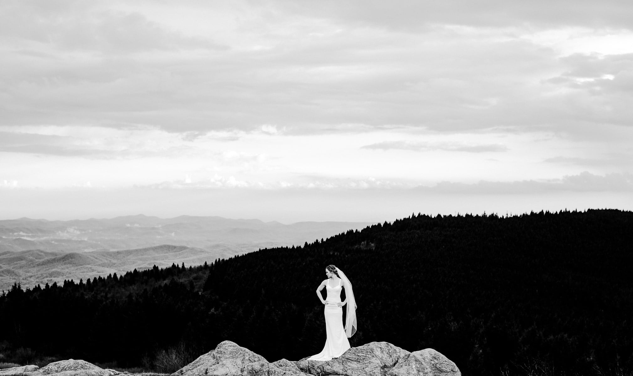 Bride on a rocky mountain during her Black Balsam Elopement
