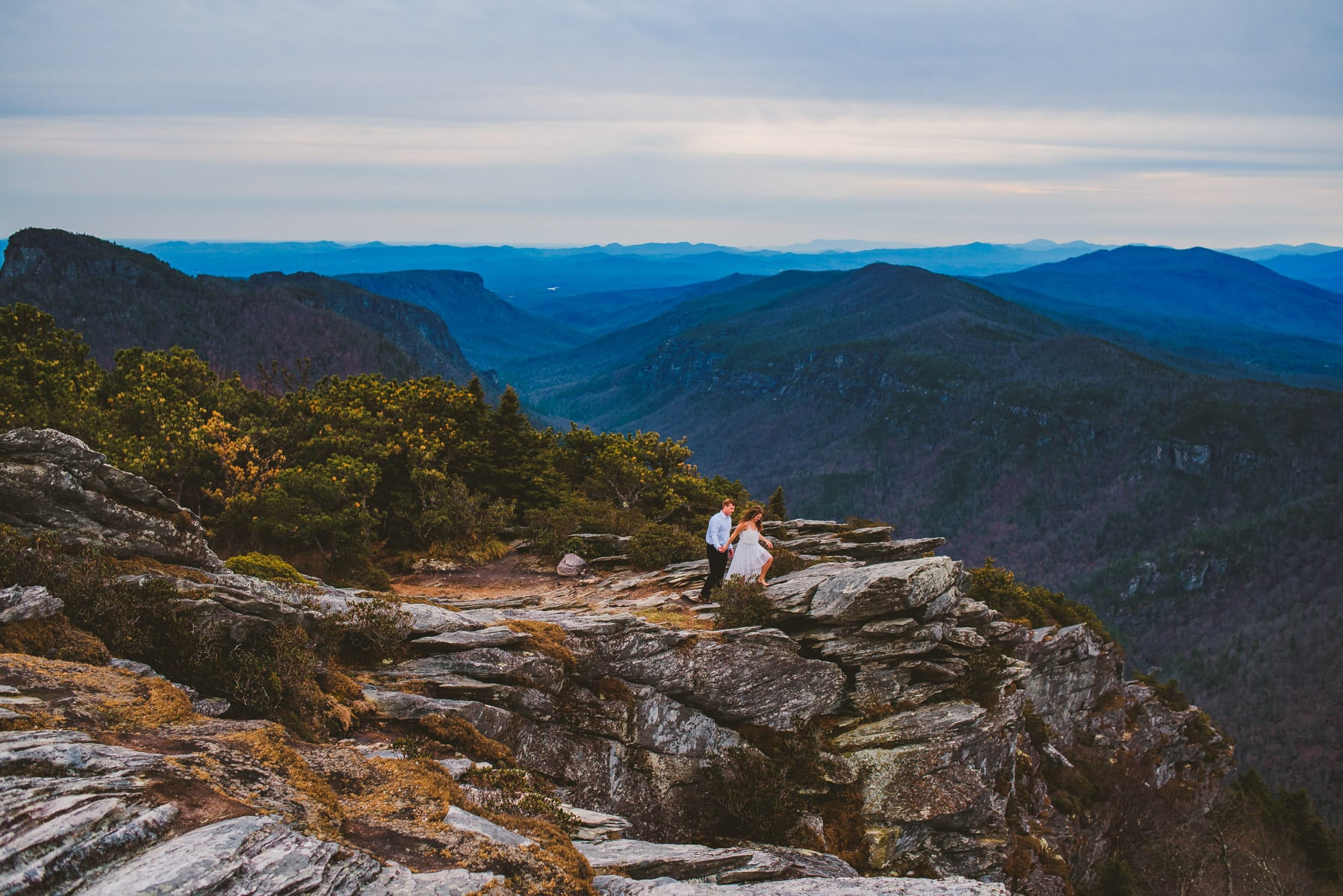 bride and groom in the wild during their hawksbill elopement in the linville gorge wilderness area