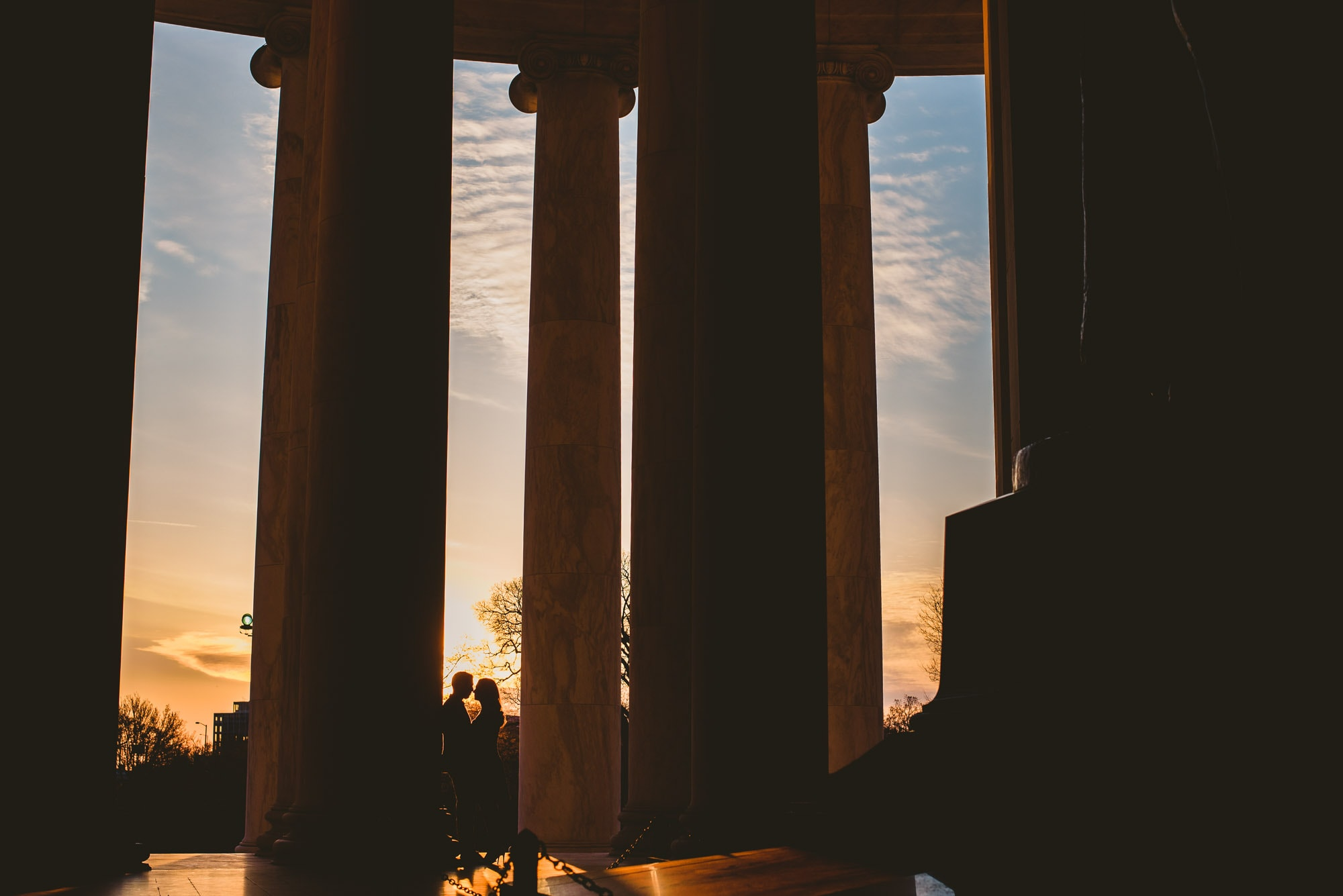 Sunrise silohuette of engaged couple at the Jefferson memorial in Washington DC