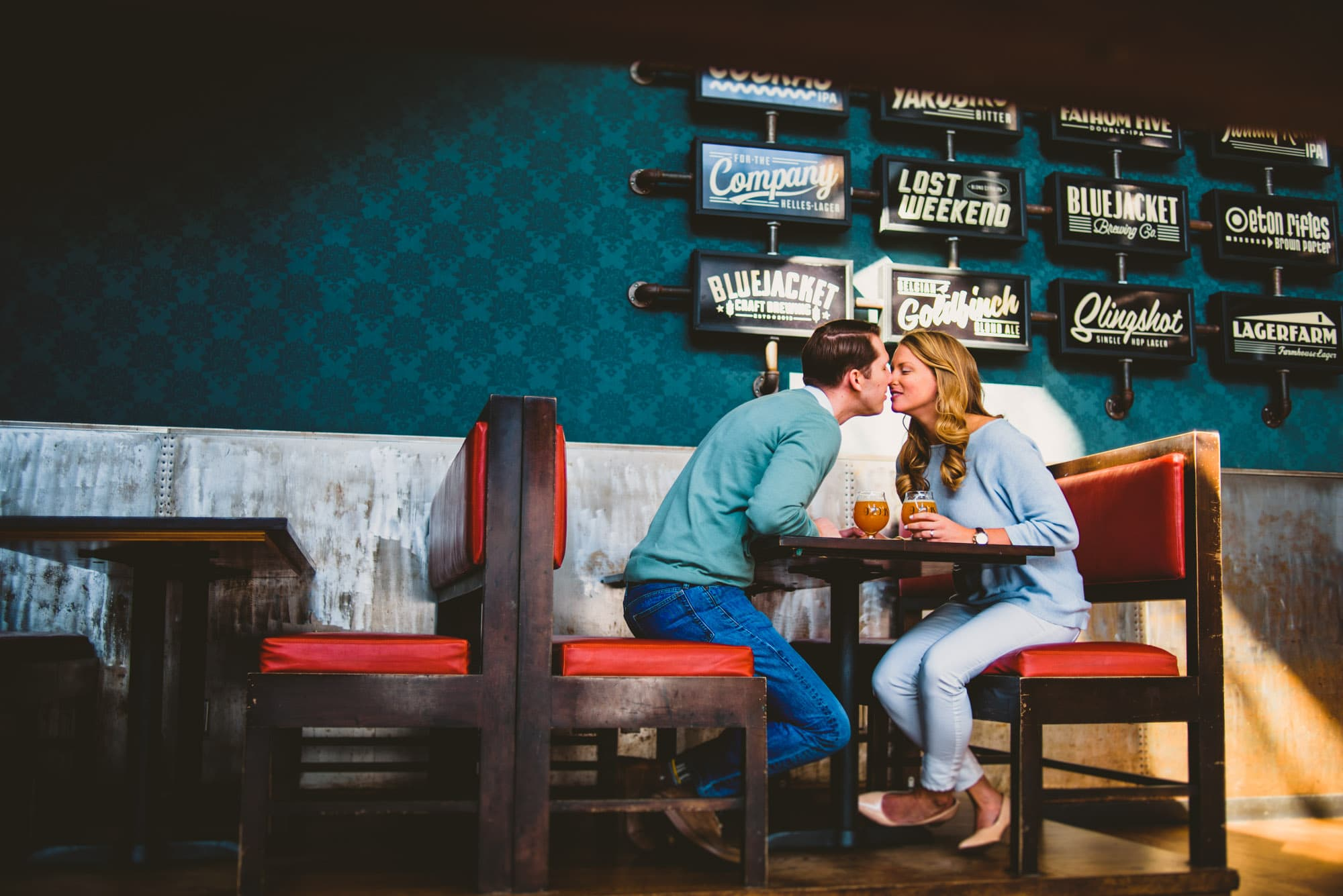 Couple sitting in a cute booth at a craft brewery