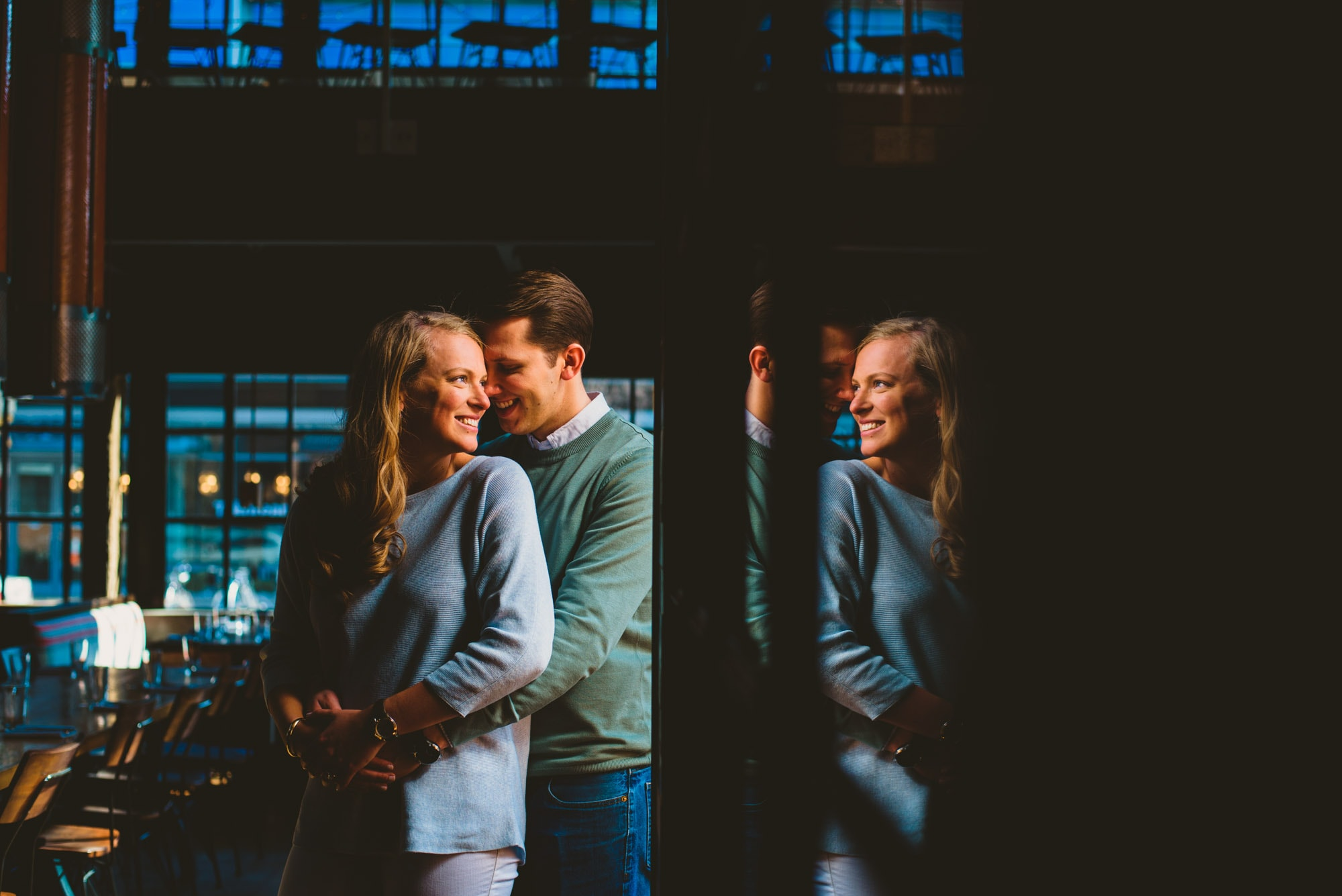Cool reflections for this image during a couples engagement session at a brewery