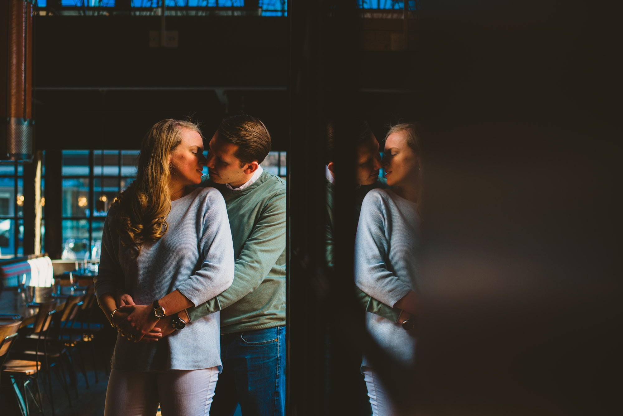 reflection of couple kissing during their engagement session at a washington dc brewery