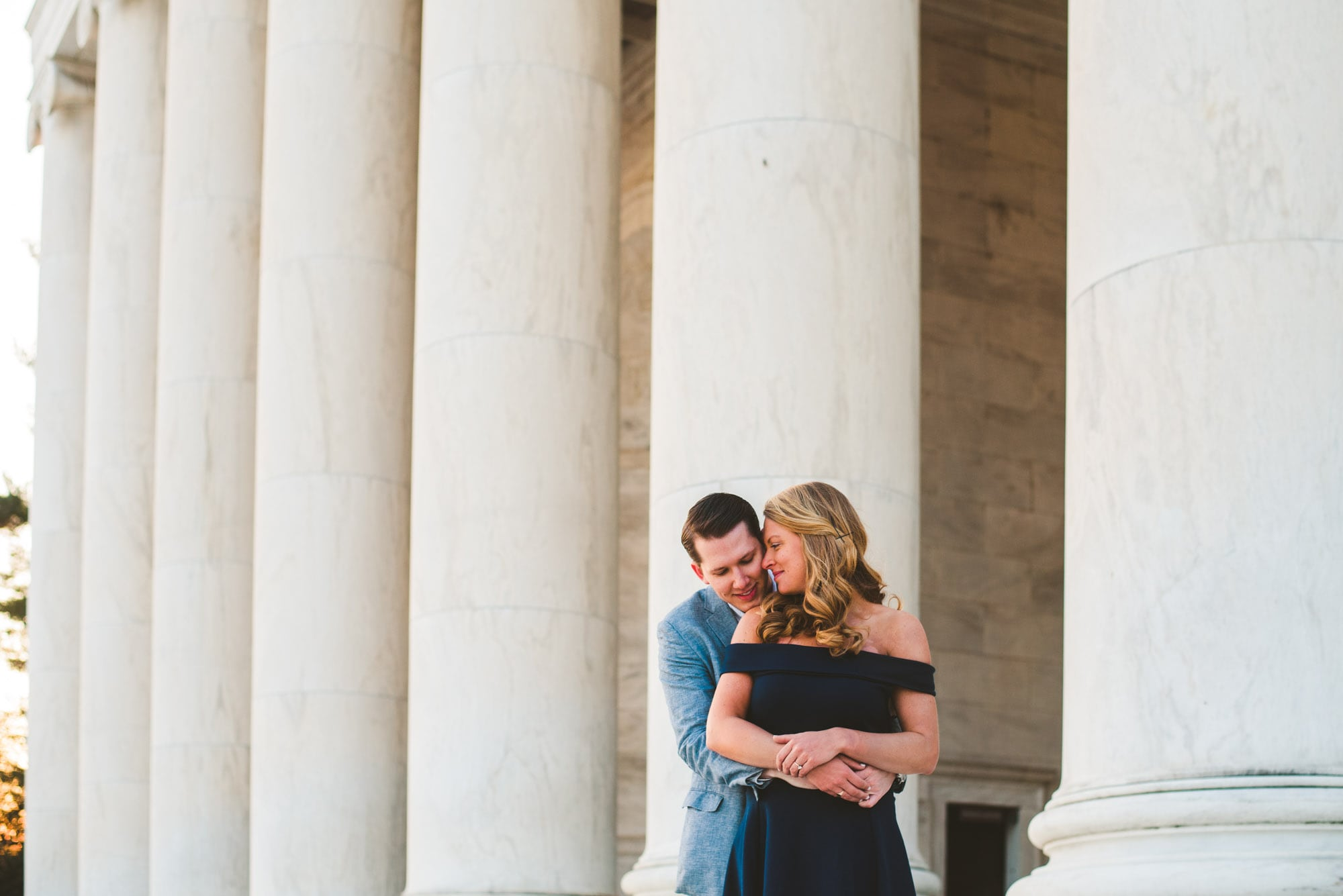 Cute couple wrapped up during their Washington DC engagement