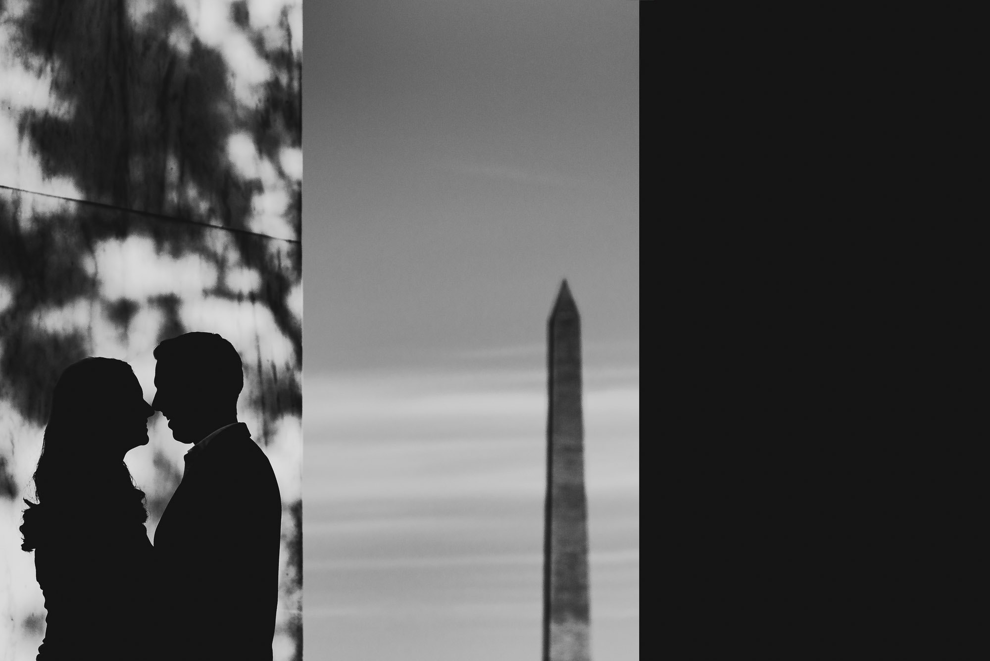 Dramatic black and white image silohuette of couple during their engagement session at the Jefferson Memorial