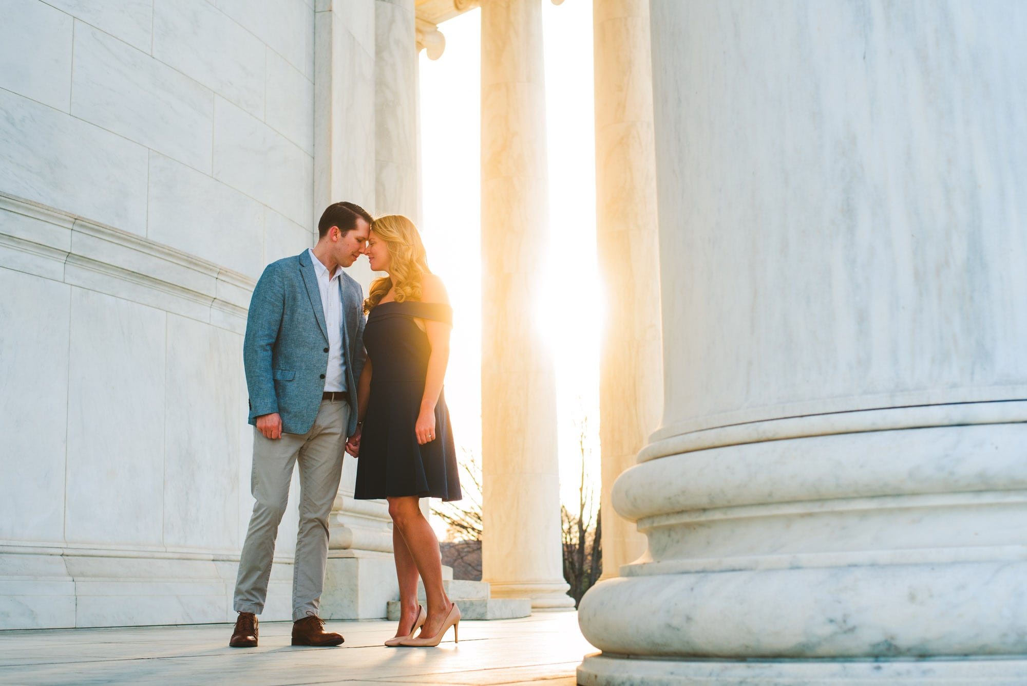 Sun peeking through the pillars at Jefferson Memorial during an engagement session.