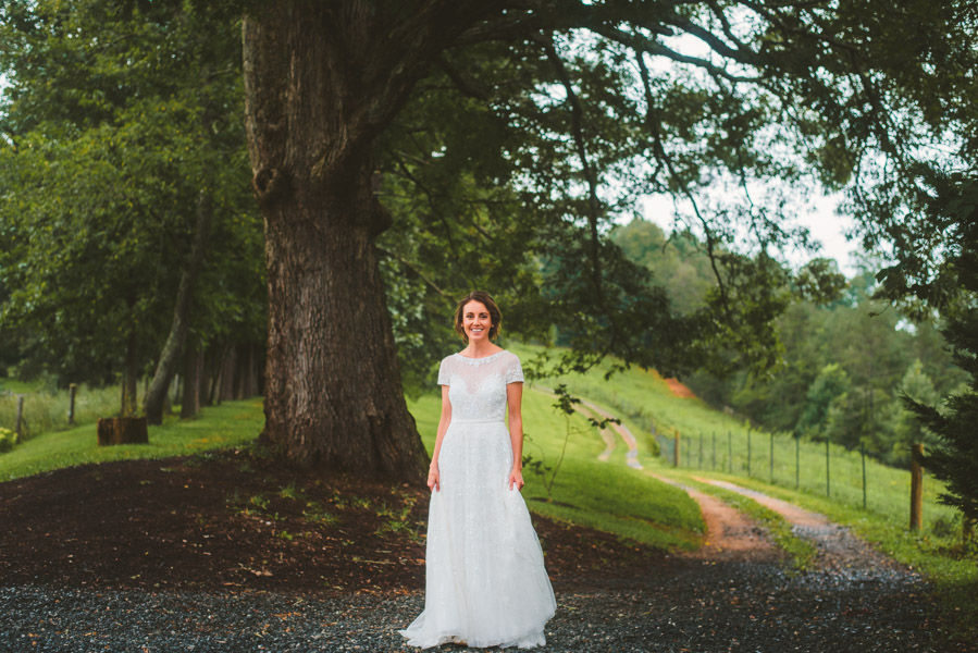 Bride on tree covered path at Yesterday Spaces a wedding venue near Asheville NC