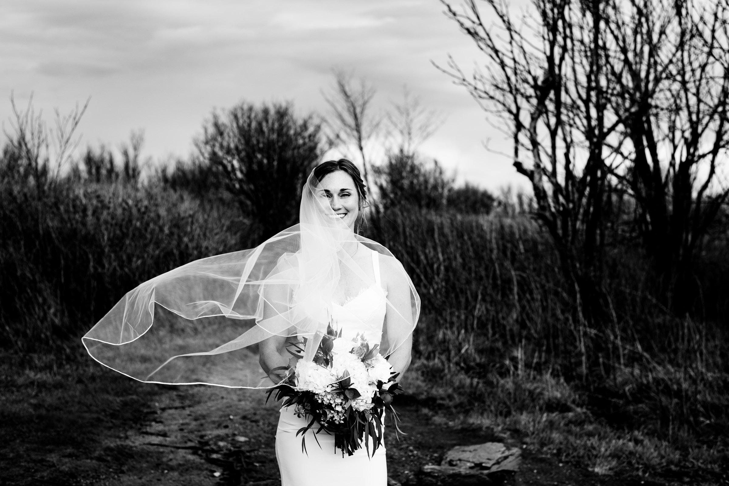 Wind blowing this adventurous brides veil