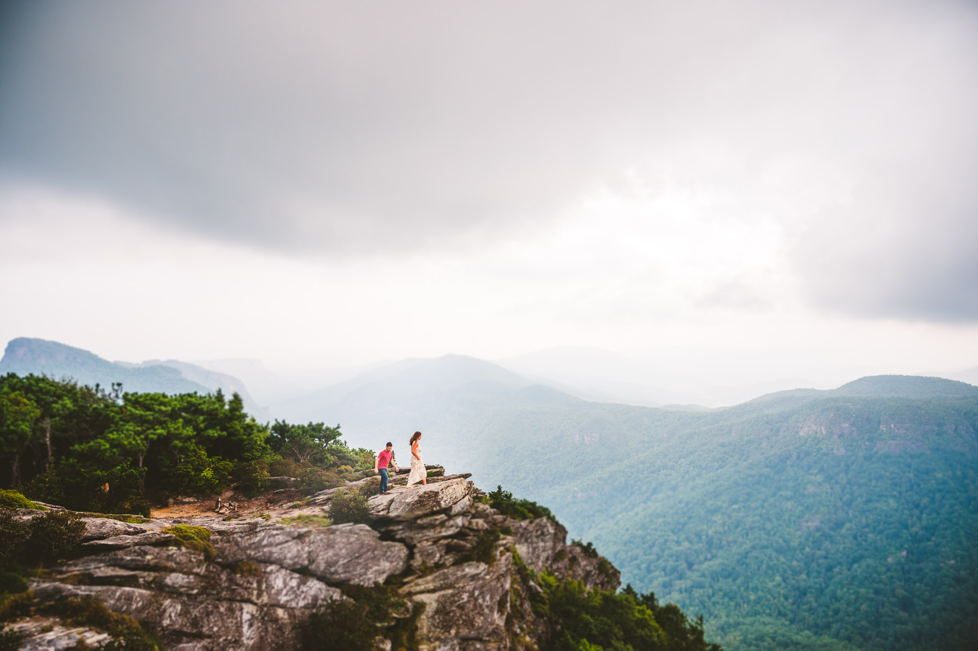 Couple exploring Linville Gorge Wilderness during adventure engagement session