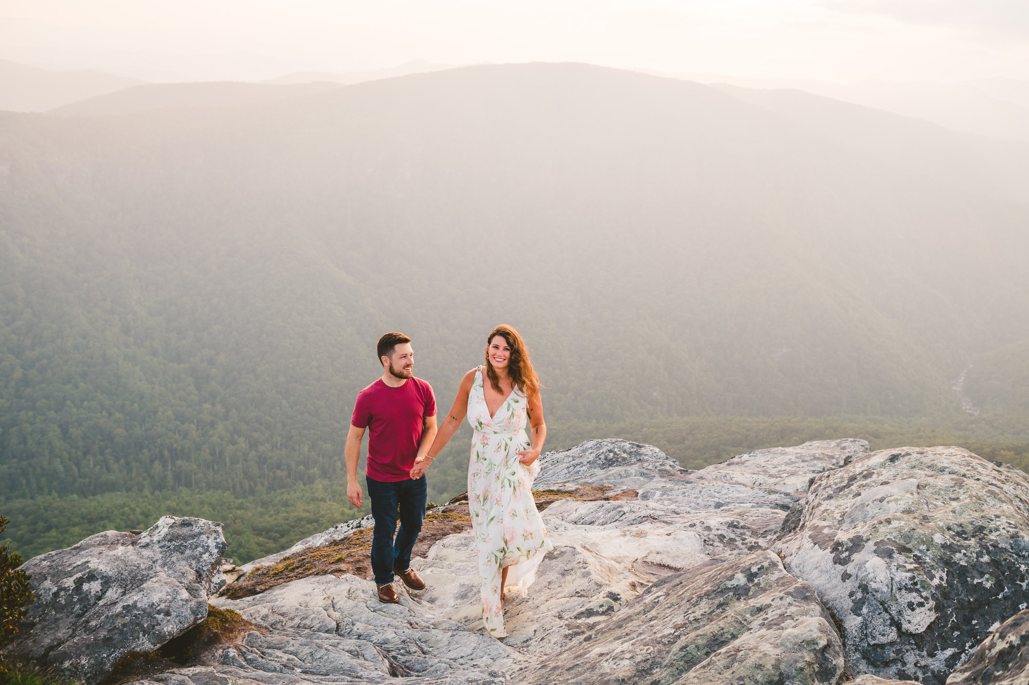 Adventure engagement session on Hawksbill Mountain at sunset