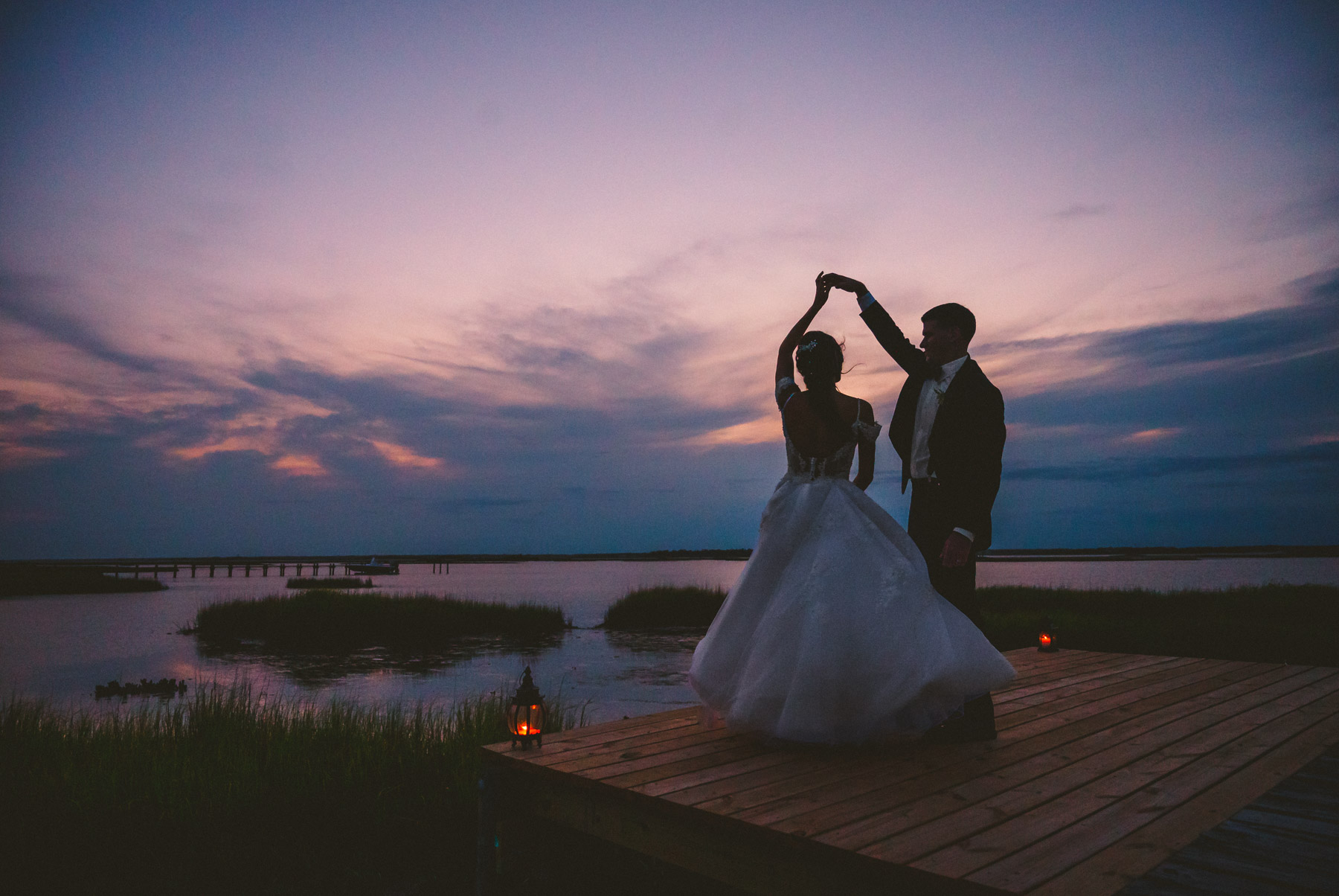 Outer banks NC elopement couple having a private first dance at sunset by the ocean