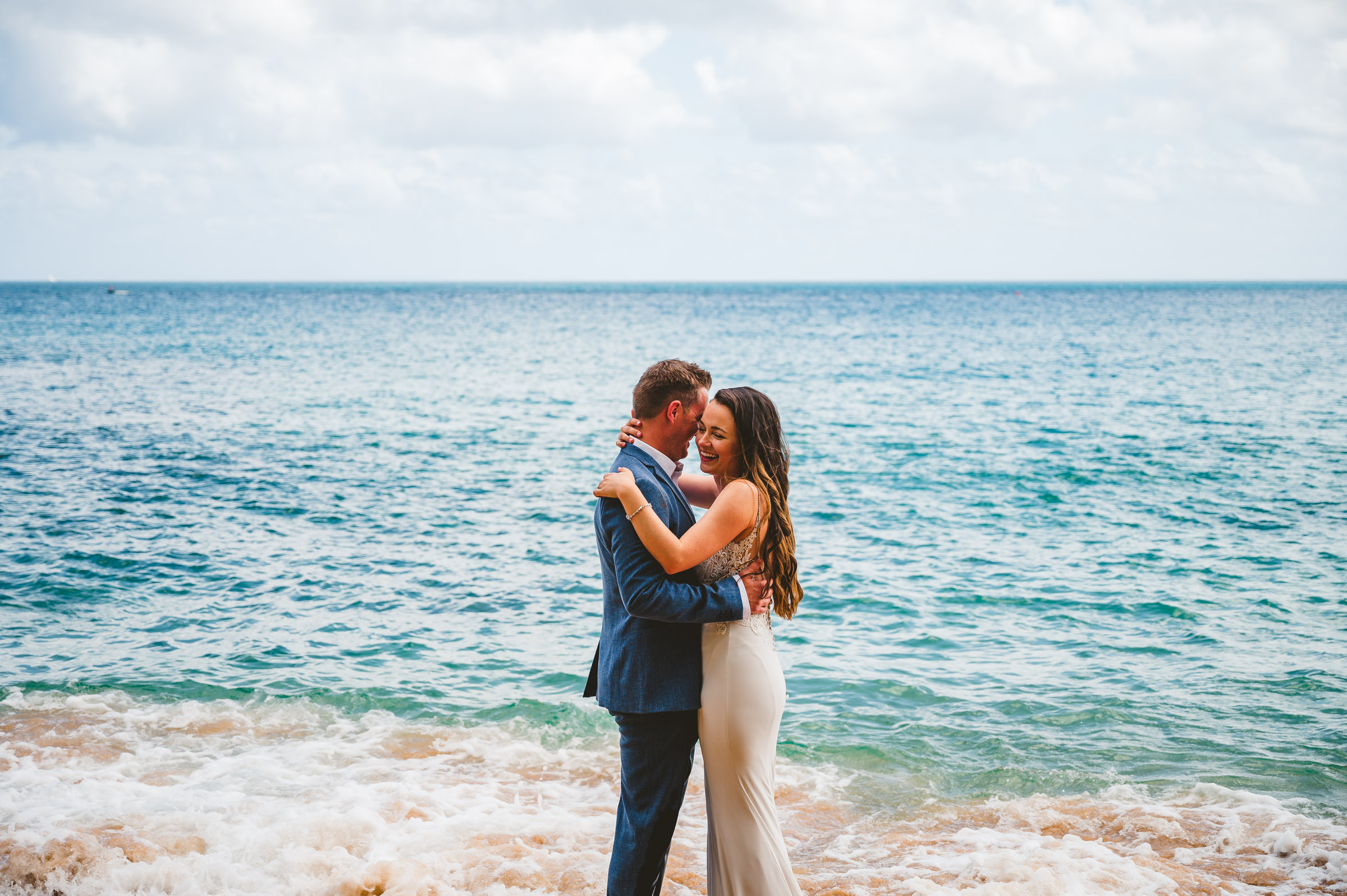 couple embracing in the ocean during St Lucia Elopement