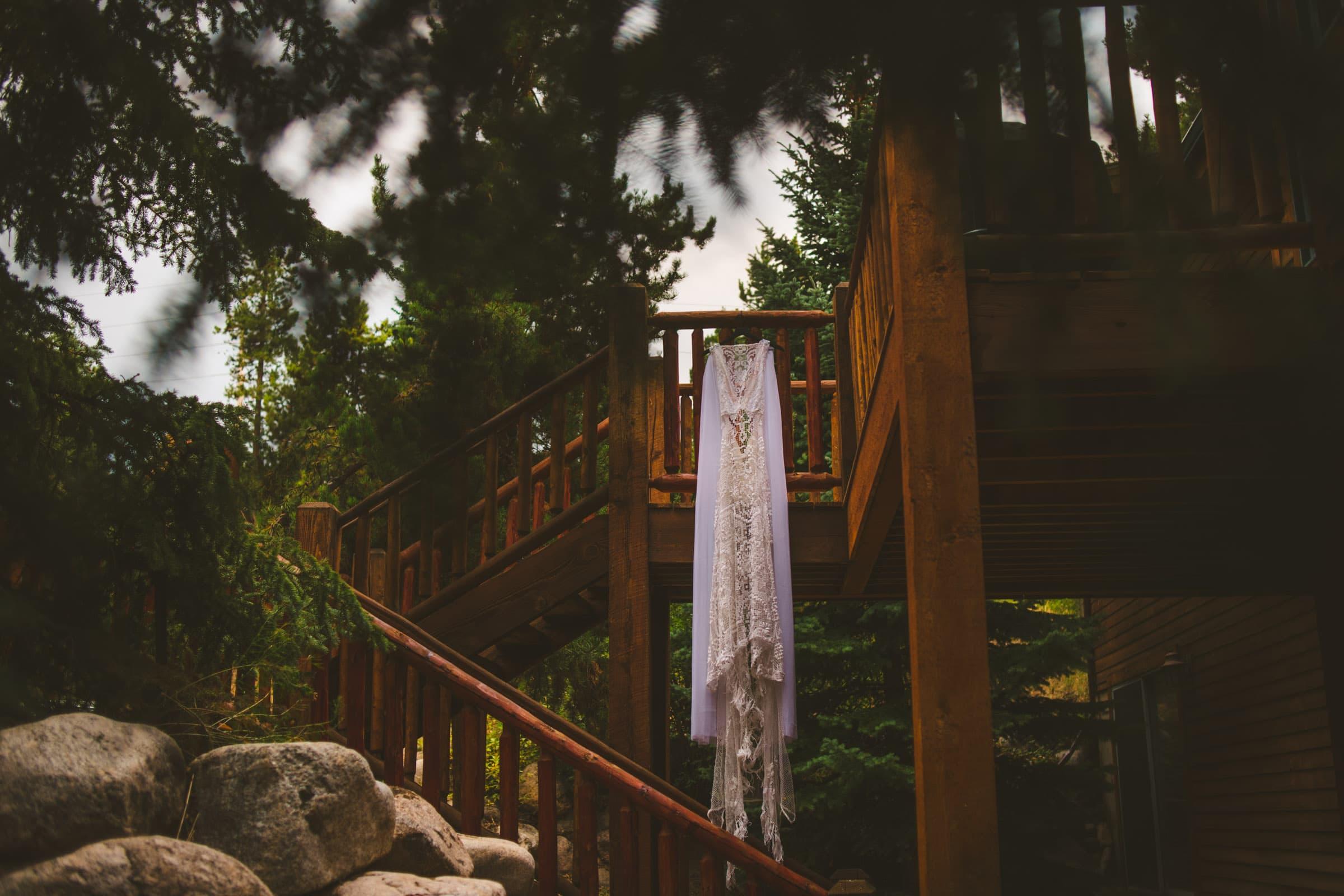 Wedding dress hanging from lodge railing near Loveland Pass Colorado